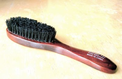 Wooden-backed paddle-style natural bristle brush/spanky toy